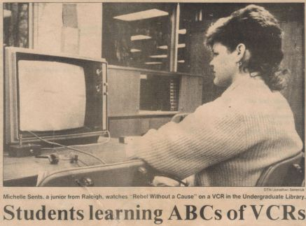 With a movie, popcorn and soda for two costing over $10, many students are electing to stay home and watch movies on a video cassette recorder.