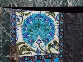 William de Morgan ceramic tiles inset into the fire place.