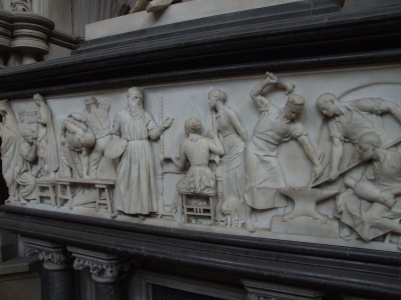 Frieze beneath the statue of the architect