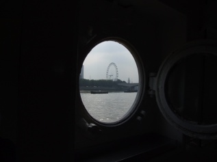 London Eye from a different perspective (the gent's toilet in HMS Wellington)