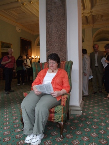 Michelle having a rest in the Durbar conference room that looks out onto the court.