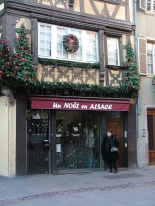 A shop specialising in Christmas things in Petite France - a district within Strasbourg with lots of medieval half-timbered buildings.