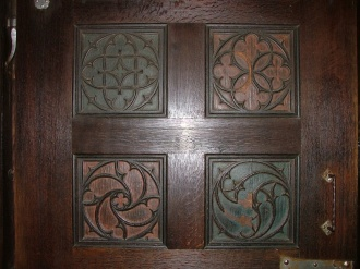 I thought these craved wooden doors were interesting. It wasn't until I looked at the photo that we discovered they were coloured. It was a rather gray day.
