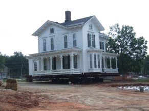 The old town houses are being moved to Blount Street so they are all in one place and not in the way of progress.