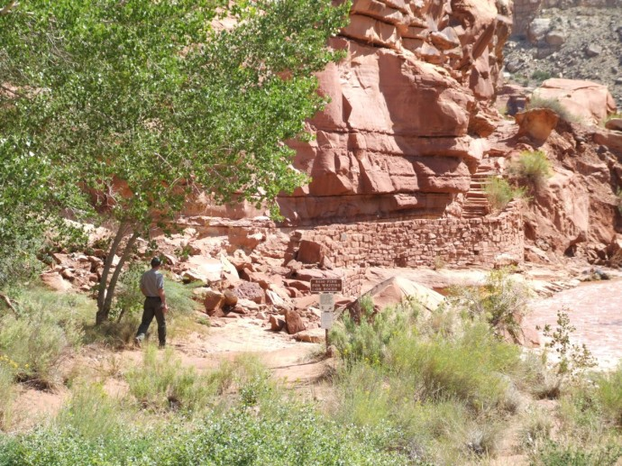 Park keeper inspecting the rock fall caused by all the recent rain