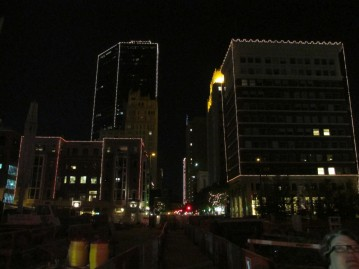 All the downtown buildings are outlined with lightbulbs at night
