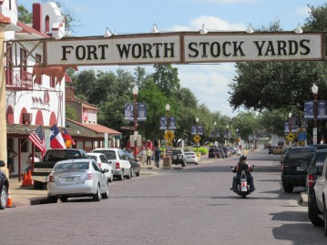 """The stockyard is overrun with Notre Dame fans. There are Arizona fans too but they are less noisy than the """"fighting Irish"""". - at Fort Worth Stockyards"""