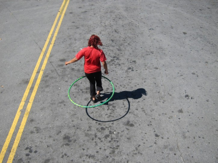 Our tour guide hula hooping