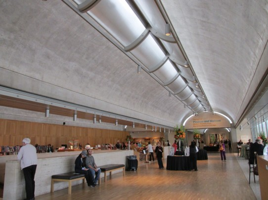 Natural light is let in though a long narrow slit and reflected off a polished curved concrete ceiling.