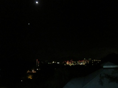 At night the yacht masts look like a city scape. Venus, the moon and Jupiter (just off picture) are bright in the sky.