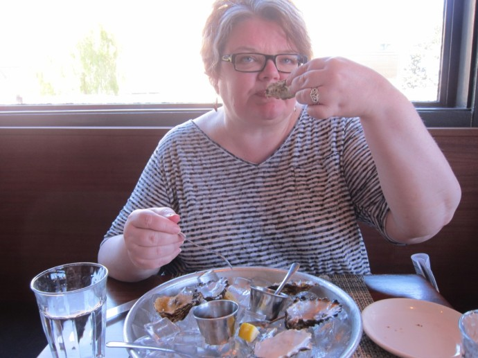 Michelle eating oysters at Stellina, Point Reyes Station