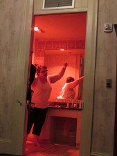 Michelle goofing around in the red light of the bathroom
