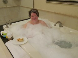 Her Ladyship enjoying breakfast in a bubble-bath jacuzzi