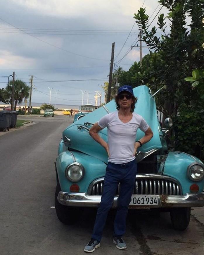 Mick Jagger posing by his car
