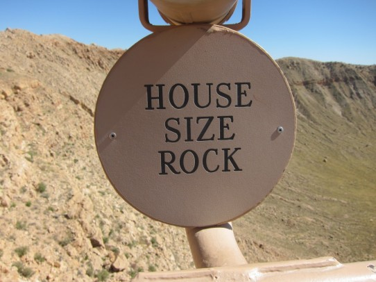 Telescope focused on house size rock on crater rim.