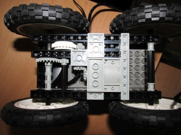 ...realise that only one motor works and redesign to use a complex gearing mechanism to drive both wheels...