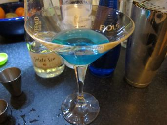DCN: Windex Martini (3 Vodka, 0.5 triple sec, 0.5 blue curcao, dash dry vermouth, twist of orange)