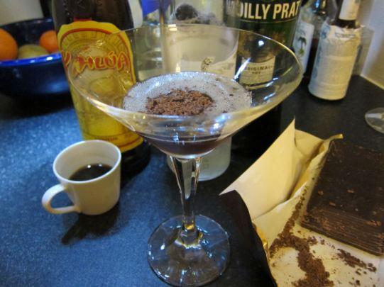 DCN: Espresso Martini (3 Vodka, 1 espresso, 1 Kahlua, dash creme de cacao, drop of dry vermouth, chocolate shavings)