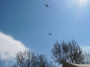 Military looking helicopters over central London
