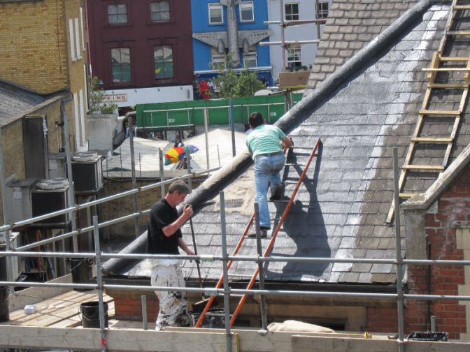They're mending the church roof with sackcloth and tar!