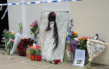 Fans leave flowers and pictures