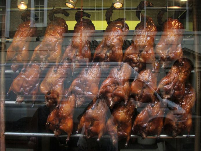 Ducks in restaurant window on Gerrard Street. Shopping for new bamboo steamers.
