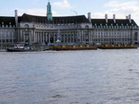 Garbage barges on the Thames, passing County Hall