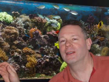 An underwater shot of Andy swimming with the fishes