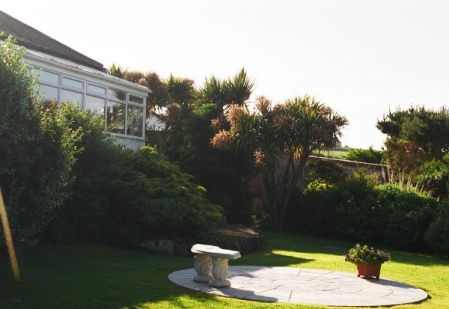 The conservatory at the back of the villa and the little patio area on the first level of the split level garden.
