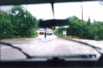The day before we left it started raining. We couldn't make it to the airport via this road and had to go on an adventure instead.